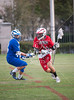 Episcopal's Knights play St. John's Mavericks in boys varsity lacrosse at Scotty Caven Field at night.  SJS wins 10-2.