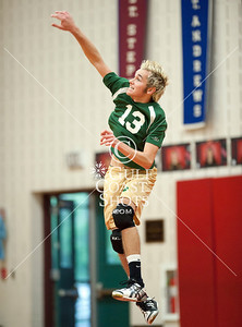 Houston's St. John's School hosts 12 mostly SPC teams in a 2-day Houston Cup men's varsity volleyball tournament. Here Greenhill's Hornets and St. Marks' Lions play in the championship game. Greenhill wins.