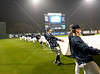 The Rice team removes the tarp as a break in the weather allows play to begin. It's a rainy Opening Day at at Reckling Park as the Rice Owls host the Florida International University Panthers in D1 baseball. Rice waits it out and gets a late 7:05 start on a 4:30 game and gets in all 9, besting the Panthers in the first of 3, 6-2. Fri., Feb 17, 2012. Houston. (Kevin B Long / Associated Press)