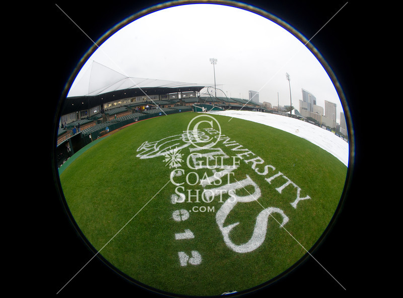 A special 360º lens frames Rice's centennial stencil amid the tarp-covered field and nearly-empty stands. It's a rainy Opening Day at at Reckling Park as the Rice Owls host the Florida International University Panthers in D1 baseball. Rice waits it out and gets a late 7:05 start on a 4:30 game and gets in all 9, besting the Panthers in the first of 3, 6-2.