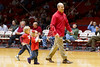 UH head football coach Tony Levine, youngsters in tow, who was named mid-season last Fall in a banner year for the Cougars that had the unintended consequence of pulling then-head coach Kevin Sumlin to Texas A&M, comes to the UH men's basketball game on Wednesday to to greet the fans and fill them in on their chances to see and meet the men the Cougars will field in the fall. The Rice Owls (14-11,54-5) men's basketball team traveled across town to Hofheinz Pavilion to take on the Cougars of the University of Houston (11-12, 3-7) in a Conference USA rivalry. After trailing by 13 in the 1st, Rice poured it on with a 2nd period 58% FG stat to win it 79-71. Houston, TX, Wed., Feb. 8, 2012 (AP Photo/Kevin B Long).