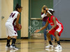 Bellaire's Lady Cards travelled to Cinco Ranch to take on the Cougars in a bi-district basketball game. Bellaire pulls within a basket, but the Cougars won 47-70.