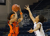 Nakachi Maduka puts up a barrier to UTEP's Janzel Nash as she shoots in the first period against Rice in Houston in a rare Sunday morning nationally-televised game the day of the Super Bowl. At the half, Rice lead with 21-20, but UTEP pulled away late to win it 45-41.