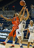 UTEP's Jenzel Nash recovers a rebound over Rice's Jessica Goswitz in the first period. The Miners of UTEP came to Rice to take on the Owls in a rare Sunday morning nationally-televised game the day of the Super Bowl. UTEP broke a late tie to pull ahead and win it 45-41.