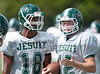 In record heat, the Crusaders of Strake Jesuit College Preparatory School in Houston practice on 120º+ turf a week before scrimmages begin, as they narrow down from 3 prospective QBs to the one that will lead them into the season.