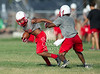The Cardinals of Bellaire High School in Texas field their Freshman, JV and Varsity teams for a daily afternoon practice at the school's fields on a 100-plus degree day, the 9th in a row.