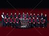 St. John's Mavericks varsity wrestlers pose for a team portrait.