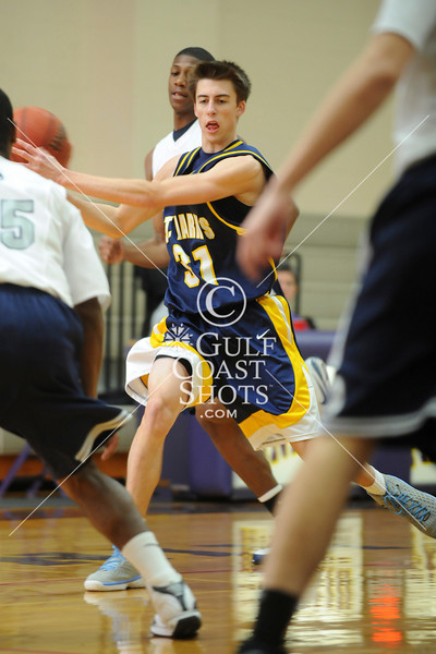 Two Dallas-area teams, the Lions of St. Marks School of Texas and the Saints of All Saints' Episcopal School head off in game 10 of the boys basketball Winter 2009 SPC Championship in Houston.