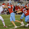Lumberton Raider David Barthol, 4, keeps the ball and fights for yardage against the Carthage Bulldogs for the 4A Area Round Playoff Friday, Nov 22, 2019 in Lumberton, Tx.  Photo: Drew Loker/Special to The Enterprise