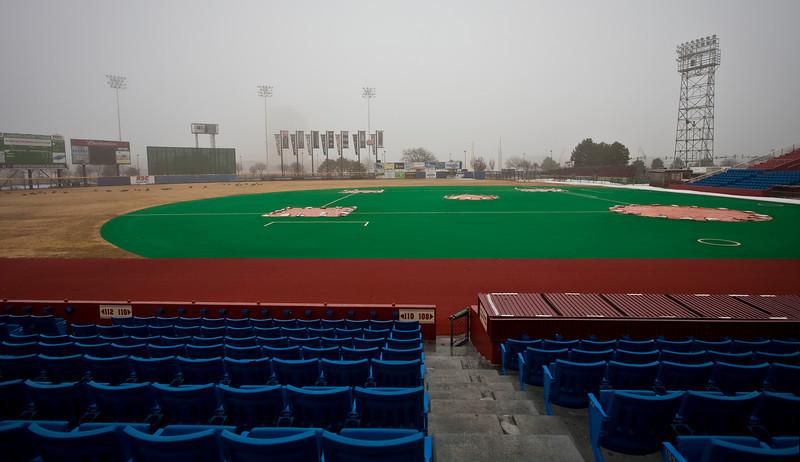 Behind the third base dugout