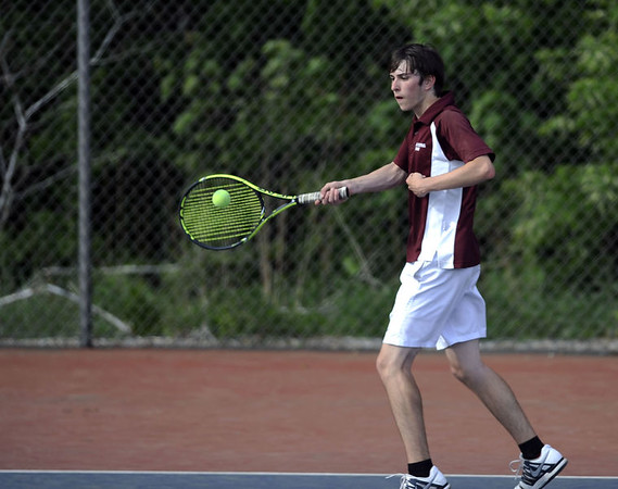 Staff Bristol Central's Nate Pileski during Friday's tennis match at PHS.