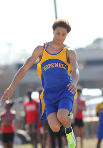 A member of Hopewell's track team competes in the long jump at the outdoor track meet on Wednesday, April 2nd. Photo by Ronnie Dayvault.