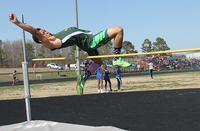 A member of the Royal;s track team competes in the high jump at the outdoor track meet on Wednesday, April 2nd. Photo by Ronnie Dayvault.