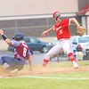 Westview's Easton Bontrager winds up for a throw as Central Noble's Chase Spencer slides into third during Monday's Class 2A Sectional 35 final at Westview High School.