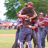 Central Noble players mob each other after winning the Class 2A Sectional 35 final over Westview in Topeka on Monday.