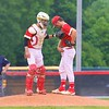 Westview catcher Nick Mortrud talks with his brother, Matt, on the mound during Monday's Class 2A Sectional 35 final against Central Noble at Westview High School.