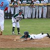 Wawasee senior Parker Young slides safely into home plate to score the first run in a game against Lakeland Thursday in Class 3A, Sectional 21 baseball action at Wawasee High School in Syracuse.
