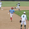 Lakeland junior Caedan Caballero, in blue, advances to third base as Wawasee shortstop Kameron Salazar, back right, makes a throw to first Thursday in Class 3A, Sectional 21 baseball action at Wawasee High School in Syracuse.