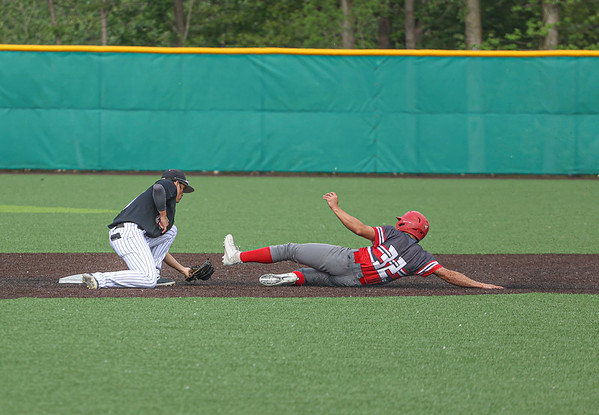 Goshen junior Mitch Daniels attempts to steal 2nd base during Thursday evening's sectional opener against Penn in Middlebury.