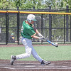 Northridge freshman Max Horner slams the ball into left field during the second inning of sectional semi-final action against Warsaw Saturday in Middlebury.