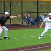 Northridge baseball coach Andrew Brabender, left, points for senior Jamon Christner to run back to third base during the second game of a doubleheader against Angola Saturday in Middlebury.