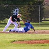 Bethany Christian sophomore Breece Erickson (12) gets under the tag of Argos sophomore Maddox Brady (19) during Wednesday's game at Bethany Christian Schools in Goshen.