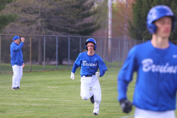 Bethany Christian senior Tyson Miller, middle, heads toward home plate after rounding third to score another run for the Bruins against Argos. Bethany won 23-1 on Wednesday at Bethany Christian Schools in Goshen.