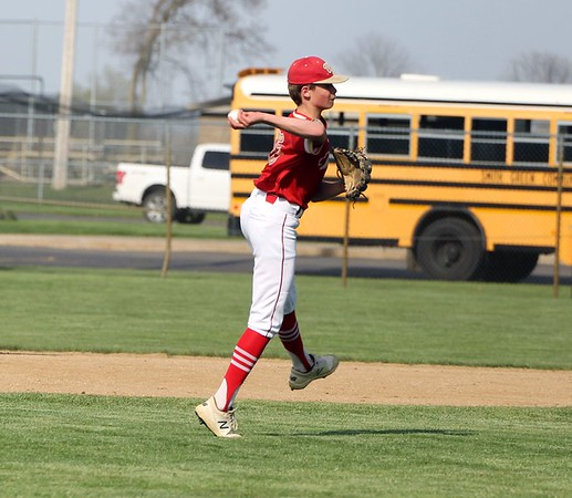 Westview freshman Braden Kauffman fires the ball to first base in the second inning of Tuesday's NECC tournament game against Churubusco in Topeka.