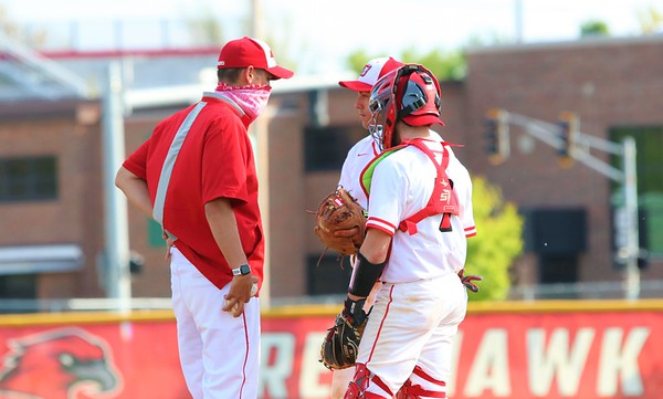 Goshen coach J.J. DuBois talks with pitcher Reece Fisher and catcher Adam Ellison during Friday's game against Concord at Goshen High School.