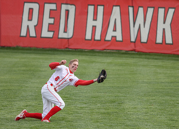 Goshen outfielder Quinn Bechtel snags a fly ball during Thursday night's home game against the Elkhart Lions.