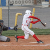 Goshen's Nathan Pinarski slams the ball into the outfield during Thursday night's home game against the Elkhart Lions.