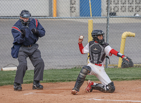 The umpire calls a strike for one of Goshen pitcher Mitch Daniels' pitches as catcher Thomas Castillo returns the ball during Thursday night's home game against Elkhart.