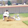 Fairfield freshman Michael Slabaugh (27) slides into second base, avoiding the tag from NorthWood senior Nate Newcomer (5). The Falcons would fall 9-7 on Friday at NorthWood High School in Nappanee.