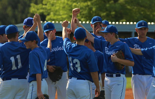 Bethany Christian huddles in the infield after finishing the top half of an inning early against Fremont on Friday at Bethany Christian Schools in Goshen.