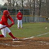 Goshen senior Colin Turner, left, gets ready to connect on a 2-RBI triple in the third inning of Goshen's 7-1 victory over West Noble Wednesday at West Noble High School in Ligonier.