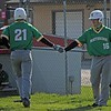 Northridge sophomore Gavin Collins (16) gives a high-five to junior Korey Beehler after Beehler scored a run in the second inning of Thursday's game against Goshen.