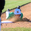 Northridge's Jesse Ryman dives back into first base after almost being picked off during Friday's game at NorthWood High School in Nappanee.