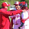 Goshen coach JJ DuBois talks to pitcher Reece Fisher and catcher Adam Ellison after coming off the field against Wawasee on Friday at Goshen High School.