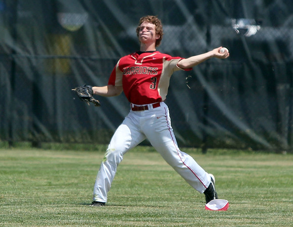 STEPHEN BROOKS   THE GOSHEN NEWS<br /> Westview senior outfielder Zach Schrock winds up to make a throw during Monday's 2A sectional championship game against Bremen at Westview. Bremen won 7-6 in 10 innings.