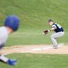 SAM HOUSEHOLDER | THE GOSHEN NEWS<br /> Fairfield third baseman Sam Brown fields a ground ball during the game against Mishawka Marian Friday.