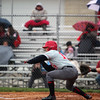 GREG KEIM | THE GOSHEN NEWS<br /> Junior Charlie Collins looks to bunt a pitch for the Goshen RedHawks in an NLC baseball game with the Northridge Raiders Wednesday night at Phend Field in Goshen.