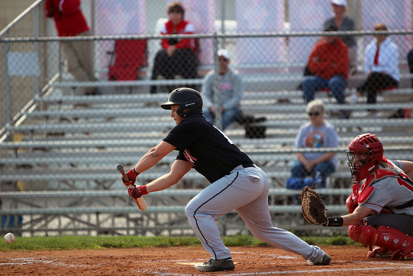 GREG KEIM | THE GOSHEN NEWS<br /> Sophomore Brant Mast executes a sacrifice bunt for the NorthWood Panthers in an NLC high school baseball contest Wednesday night with the Goshen RedHawks at Phend Field in Goshen.