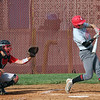 STEPHEN BROOKS | THE GOSHEN NEWS<br /> Goshen senior James Paetkau, right, swings at a pitch during Wednesday's home game against Plymouth. Goshen lost 8-6.