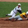 STEPHEN BROOKS   THE GOSHEN NEWS<br /> Concord junior Quinn Miller, left, tags Northridge junior Camm Nickell in a rundown between first and second base during Monday's game at Concord. Northridge won 8-6.