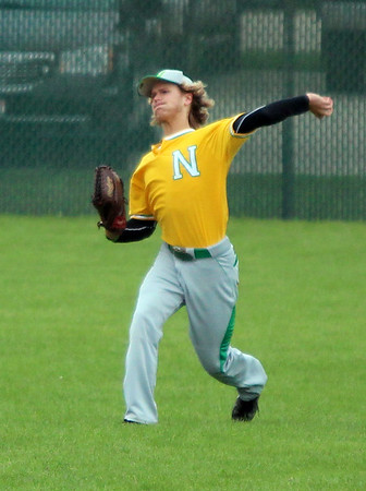 STEPHEN BROOKS   THE GOSHEN NEWS<br /> Northridge senior Andy Ross makes a throw from the outfield during Monday's NLC contest at Concord. Northridge won 8-6.