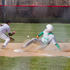 SAM HOUSEHOLDER | THE GOSHEN NEWS<br /> Northridge NUMBER 20 slides safe into third as NorthWood third baseman Hunter Lane catches the ball Wednesday during the game.