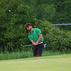 Concord's Will Harris chips a shot onto the green during Friday's boys golf sectional at Meadow Valley Golf Club in Middlebury.