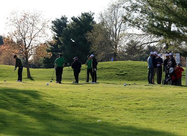 The Northridge boys golf team, left, and NorthWood team prepare for the second tiebreaker hole at the Goshen Invitational Saturday at Black Squirrel Golf Club.