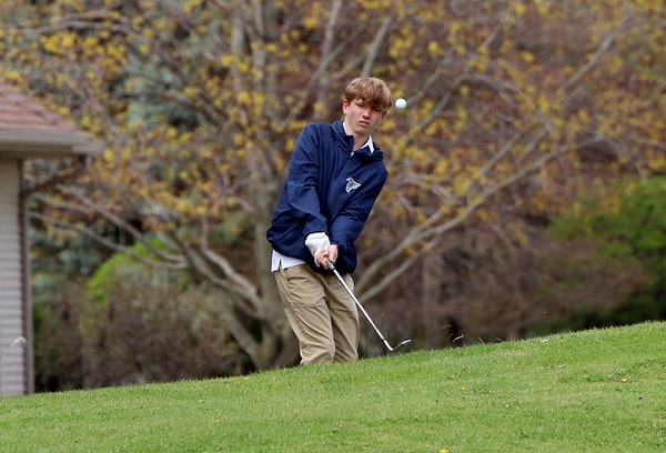 Fairfield's Carter Kitson chips onto the green at the first hole during the Goshen Invitational Saturday.
