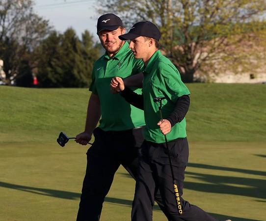 Northridge's Tyler Frazier, left, and Brock Reschly fist bump after the Raiders won the second tiebreak hole over NorthWood, winning the Goshen Invitational Saturday at Black Squirrel Golf Club.